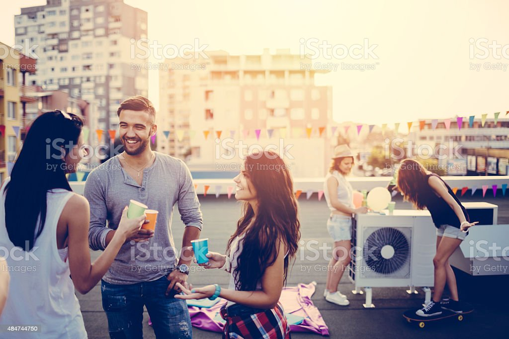 Friends on a rooftop party stock photo