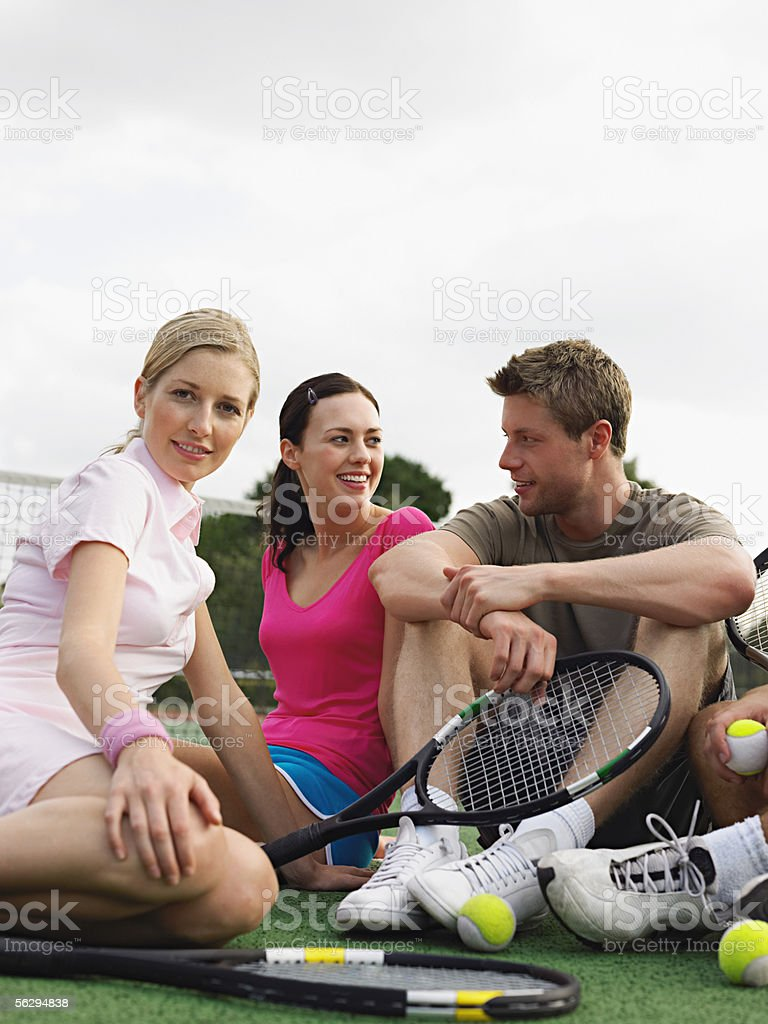 Friends on a tennis court stock photo