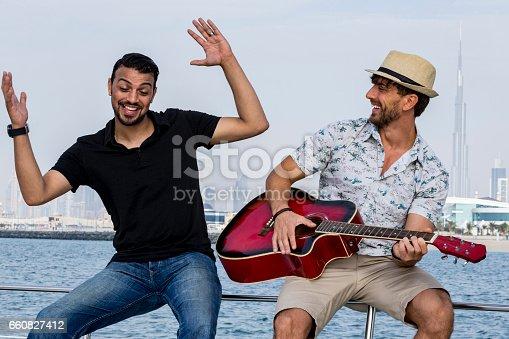 istock Friends on a yacht enoying their weekend in Dubai 660827412