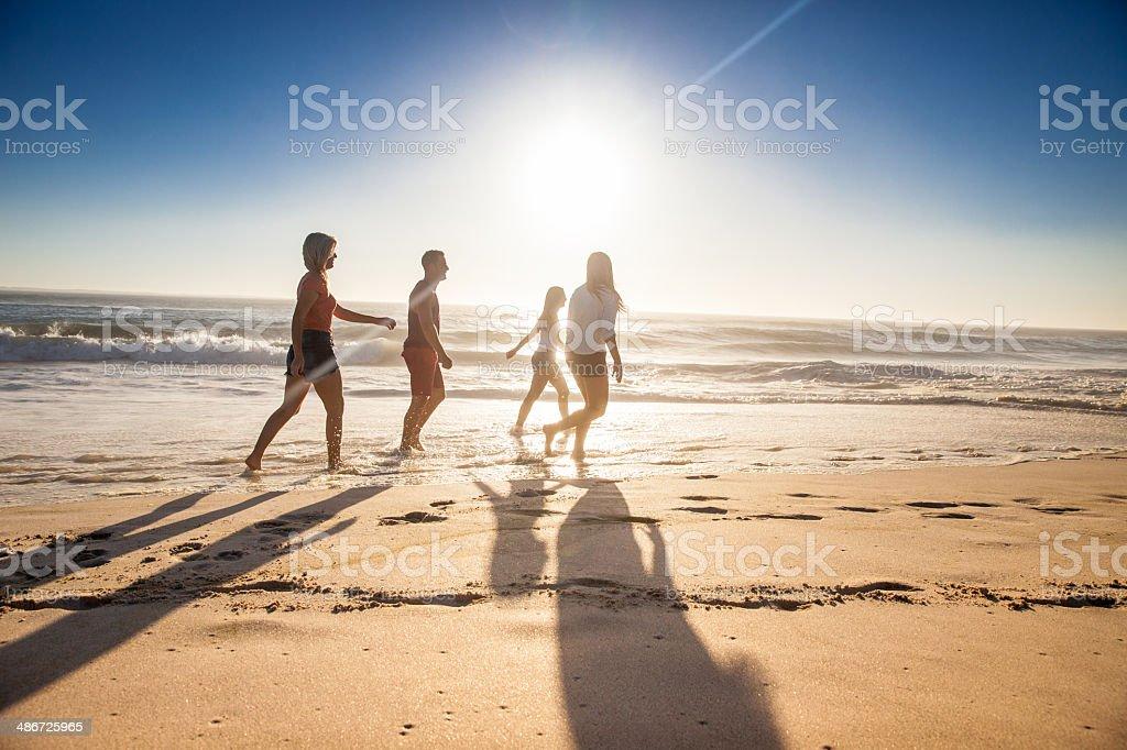 Friends on beach stock photo