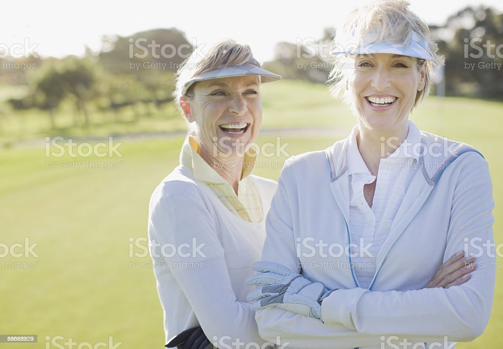 Friends on golf course 免版稅 stock photo