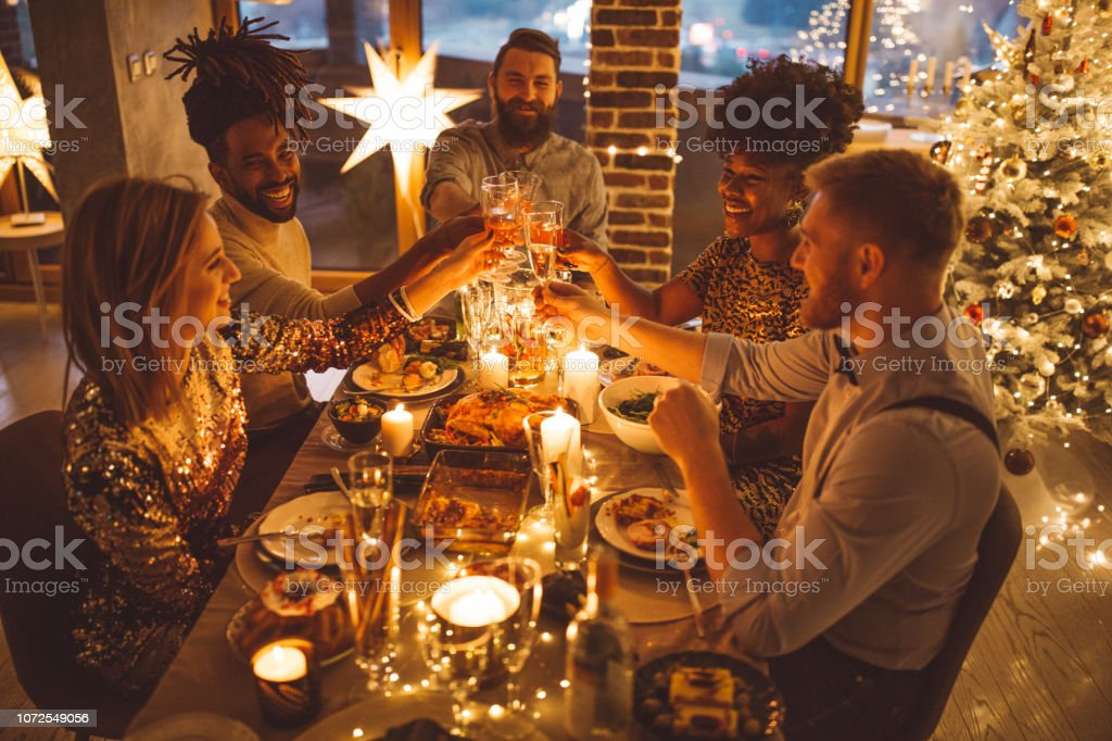 Friends on new year dinner party stock photo