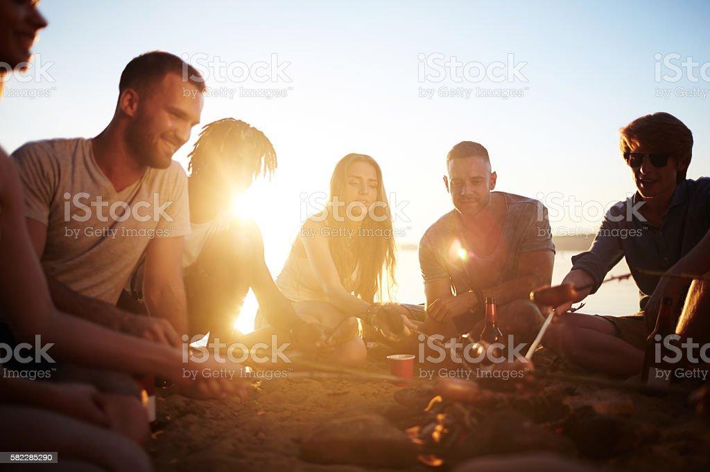 Friends on sandy beach stock photo