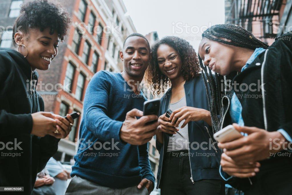 Friends on Smart Phones in New York stock photo