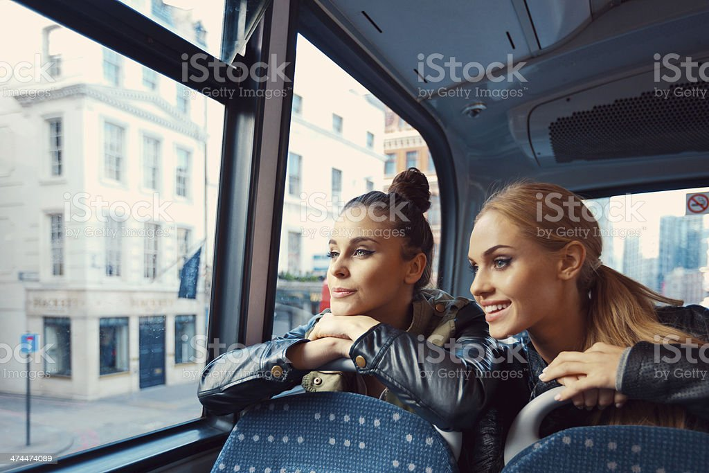 Friends on the public bus stock photo