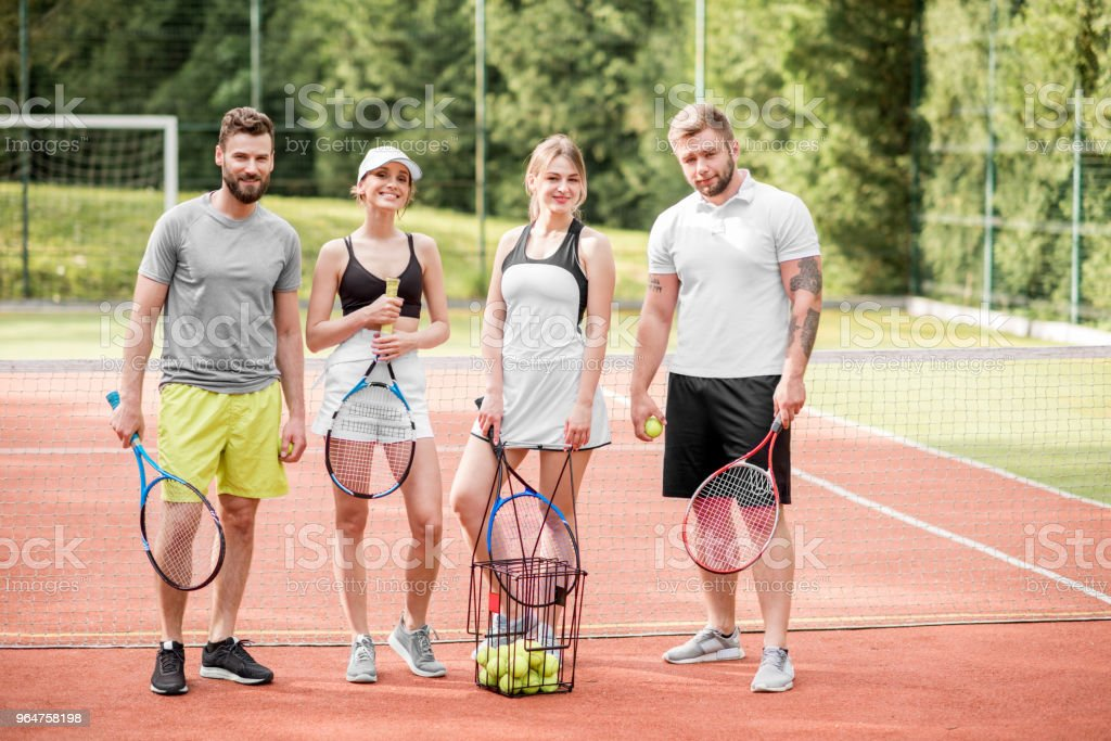 Friends on the tennis court royalty-free stock photo