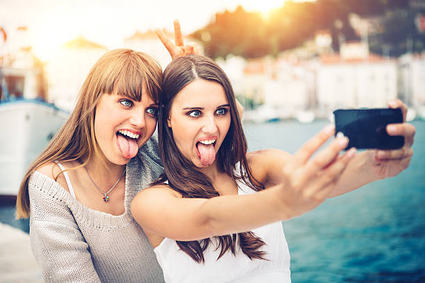 friends on vacations - sticking out tongue stock photos and pictures