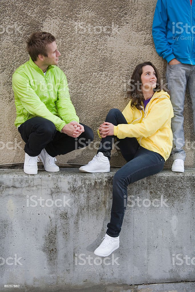 Friends on wall royalty-free stock photo
