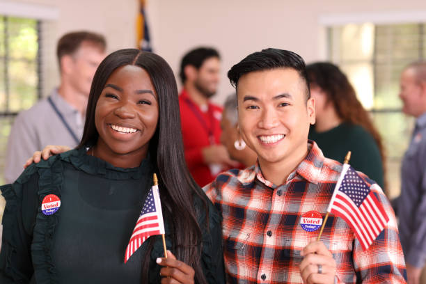 Friends or couple is all smiles as they vote in USA election. stock photo