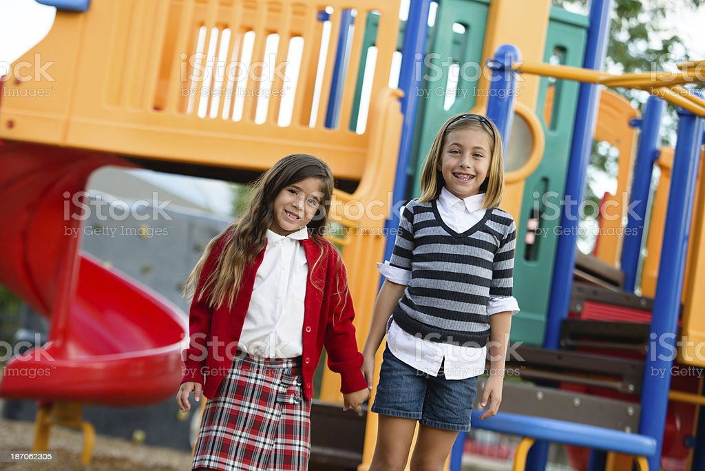 Friends or Sisters on the Playground royalty-free stock photo