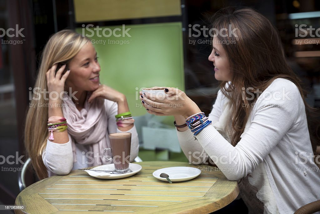 Friends out having a coffee royalty-free stock photo