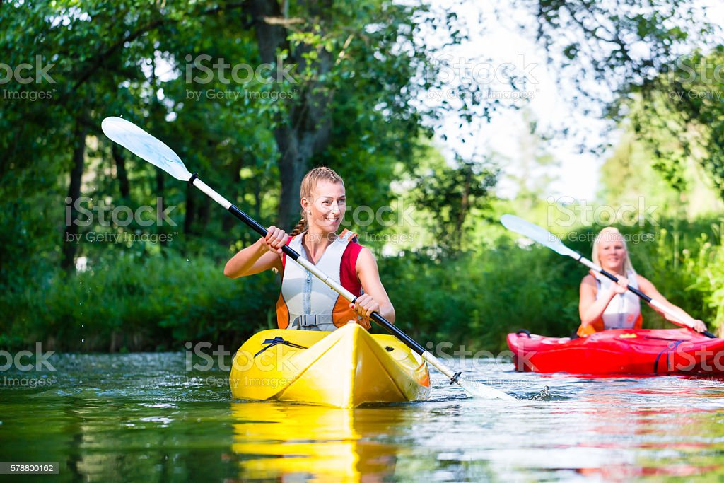 Friends paddling with canoe on forest river royalty-free stock photo