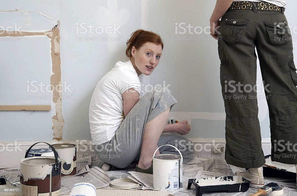 Friends painting on a wall royalty-free stock photo