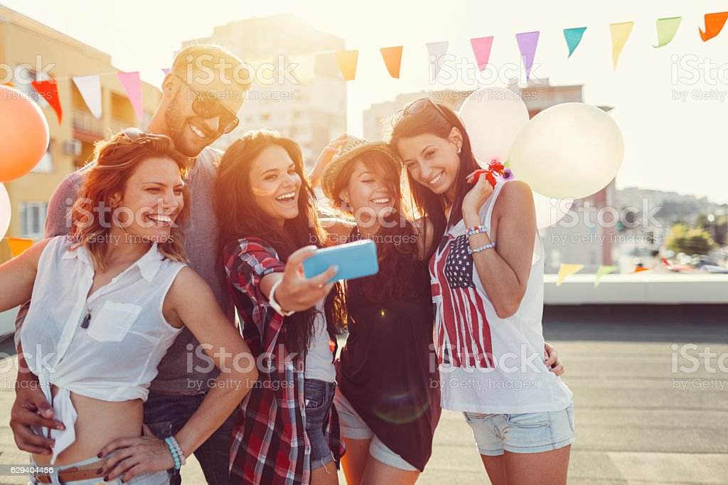 Friends partying on the rooftop stock photo
