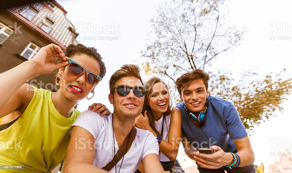 Friends Low angle view of happy friends, smiling at camera. 20-24 Years Stock Photo