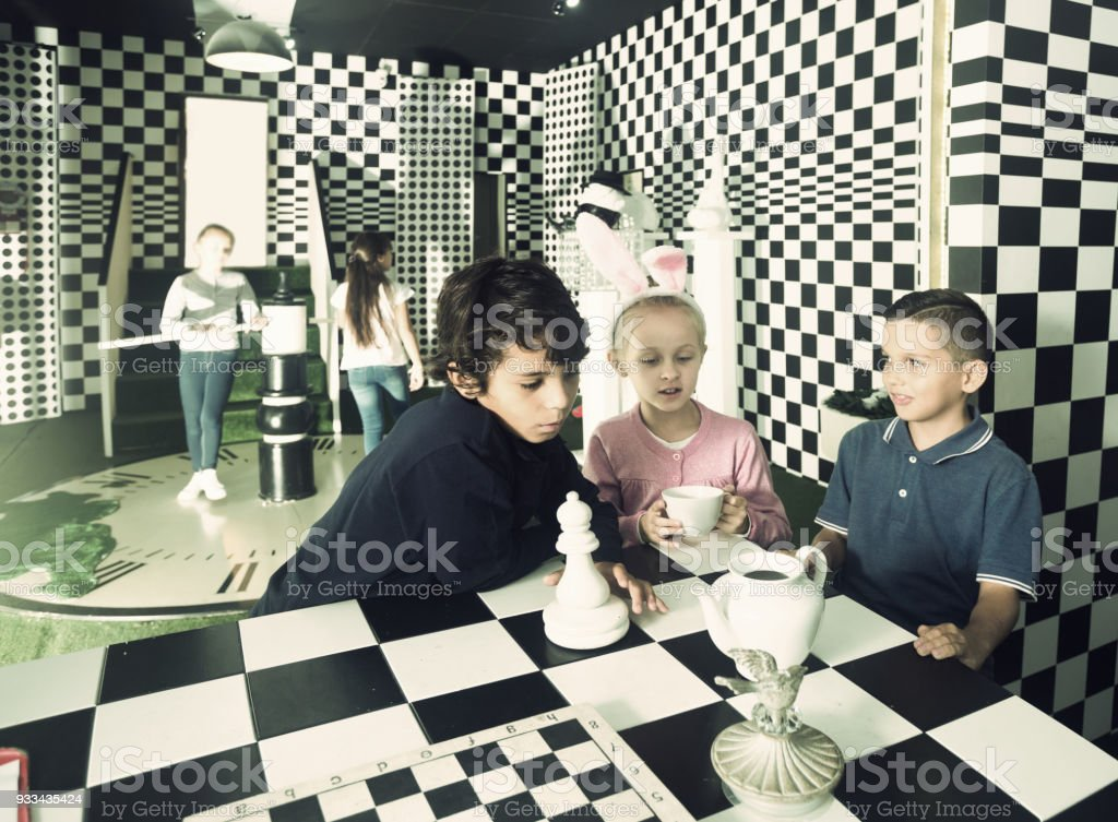 friends play in quest room in chess style stock photo