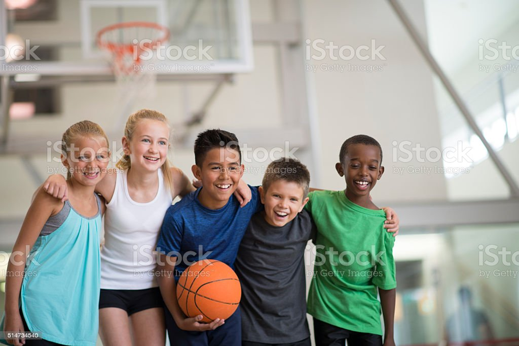 Friends Playing a Basketball Game stock photo