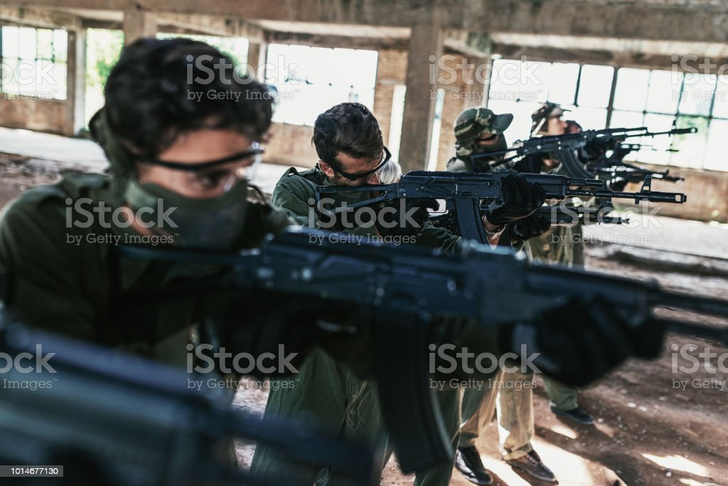 Friends playing airsoft games on the battlefield stock photo