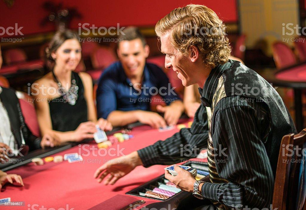 Friends playing at poker at Casino stock photo