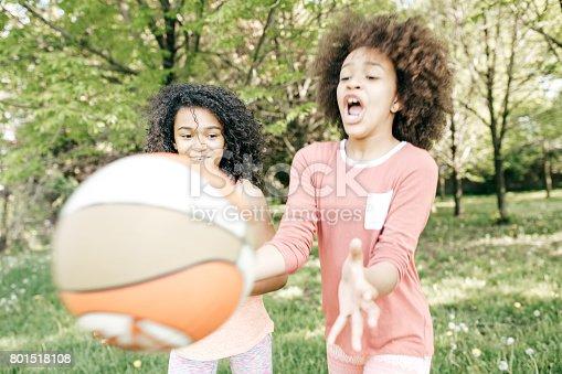1082195070 istock photo Friends playing basketball 801518108