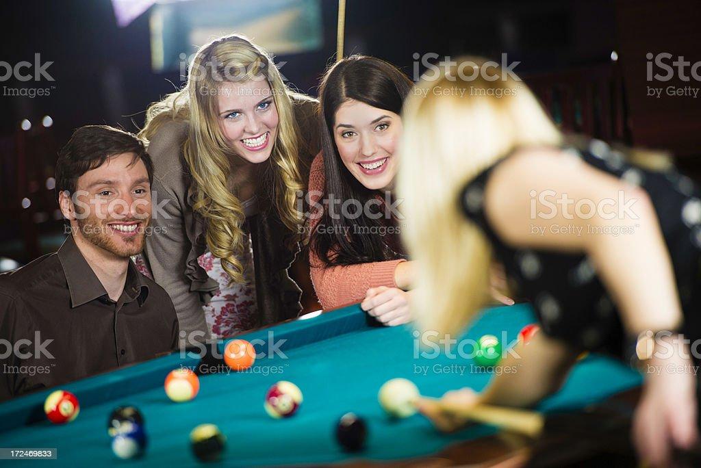 Friends playing billiard royalty-free stock photo