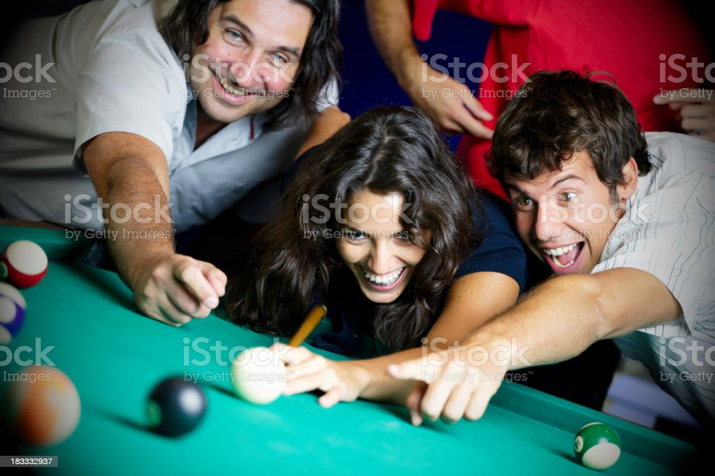 friends playing billiard royalty-free stock photo