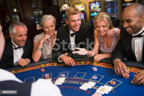 istock Friends playing blackjack in casino 96636597
