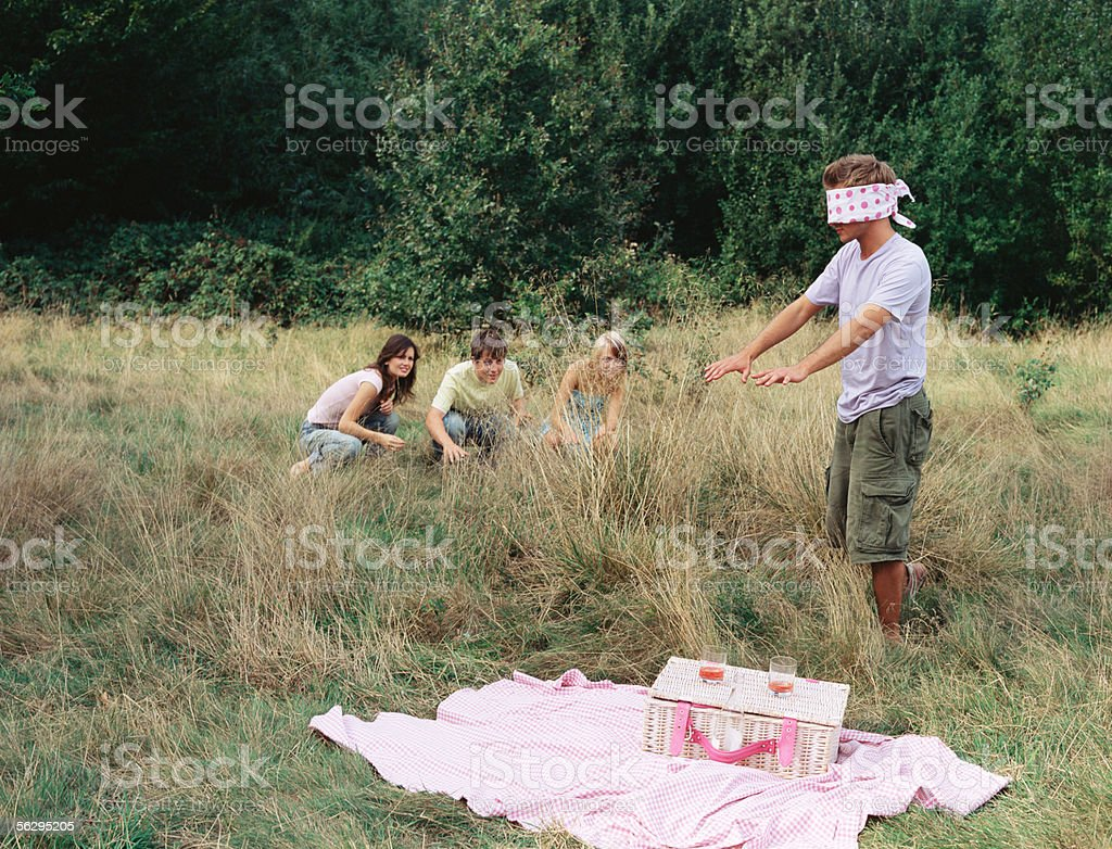 Friends playing blind man's bluff stock photo