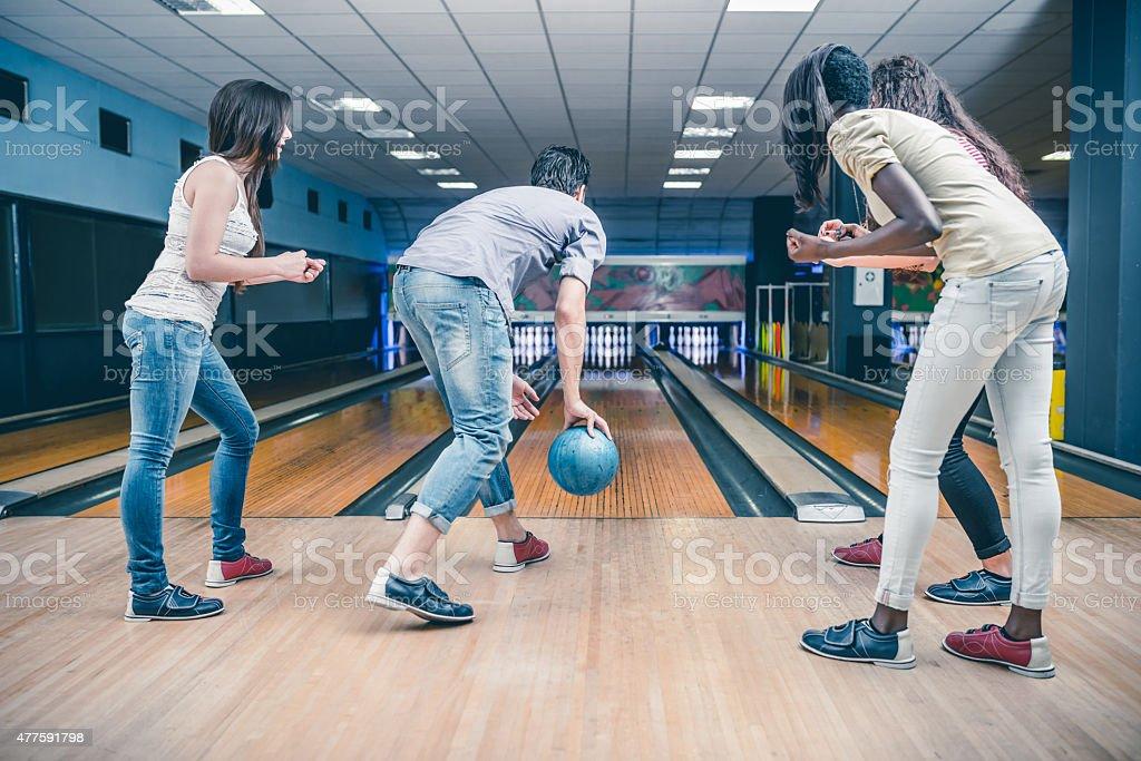 Friends playing bowling stock photo