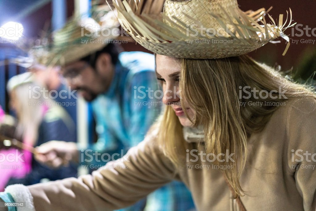 Friends playing fishing in the famous Brazilian Junina Party - Royalty-free Adult Stock Photo