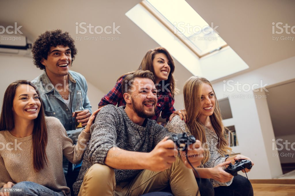 Friends playing games stock photo