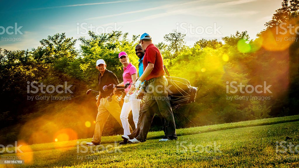 Friends Playing Golf on a Beautiful Sunny Day stock photo