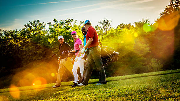 friends playing golf on a beautiful sunny day - golf stock photos and pictures