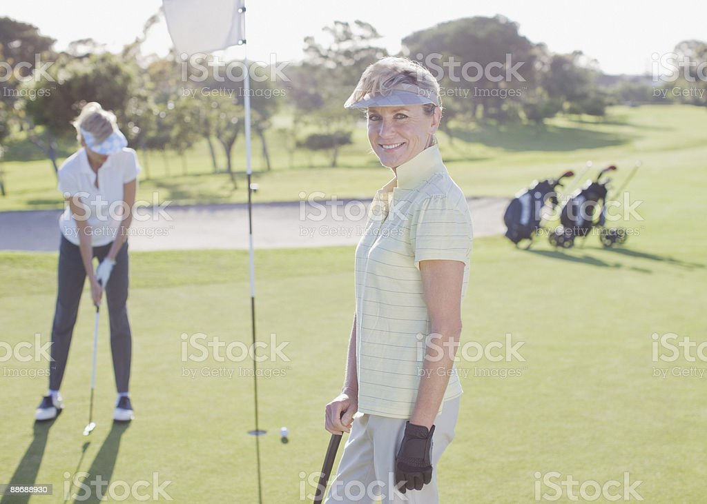 Friends playing golf 免版稅 stock photo