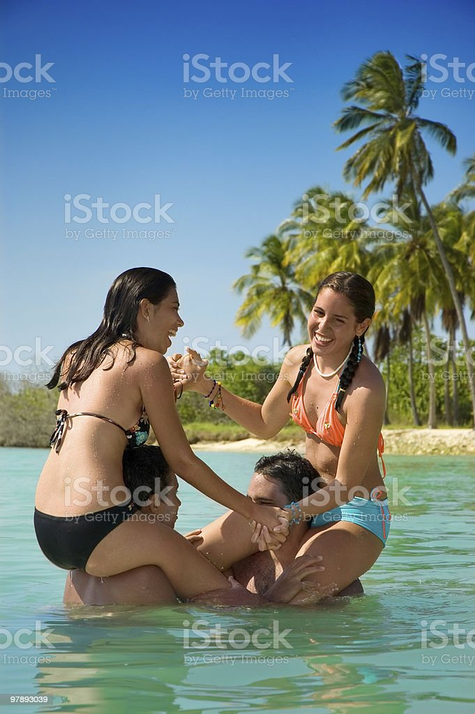 Friends playing in the beach royalty-free stock photo