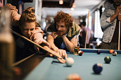 Friends playing pool