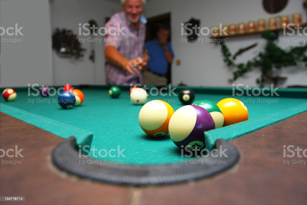 Friends playing pool stock photo
