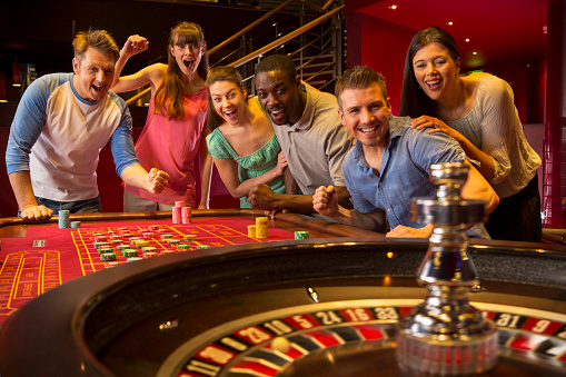 istock Friends Playing Roulette 496586451