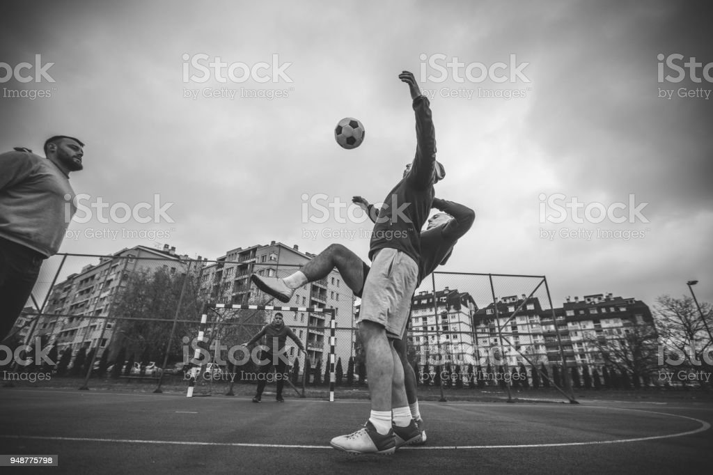 Friends playing soccer stock photo