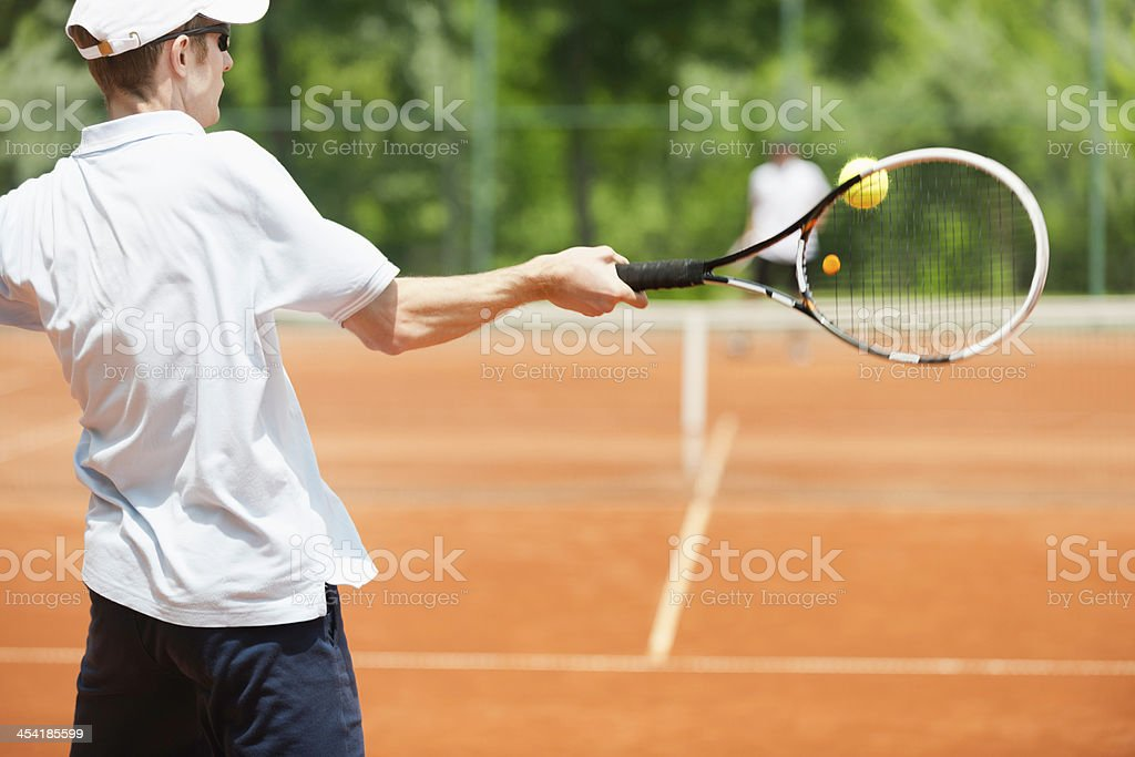 Friends playing tennis royalty-free stock photo