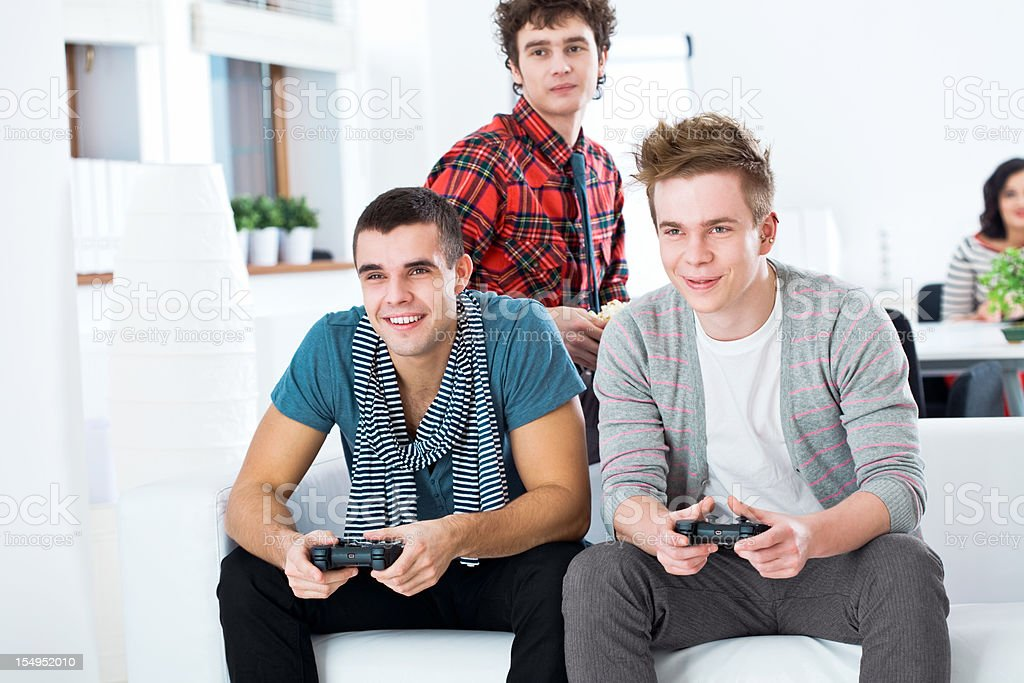 Friends playing video game royalty-free stock photo