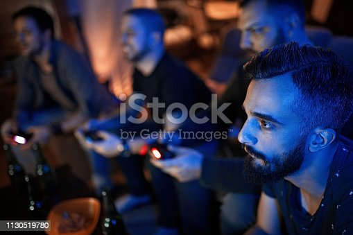 Group of friends playing video game at night