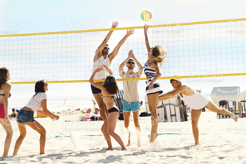 Friends playing volleybal stock photo