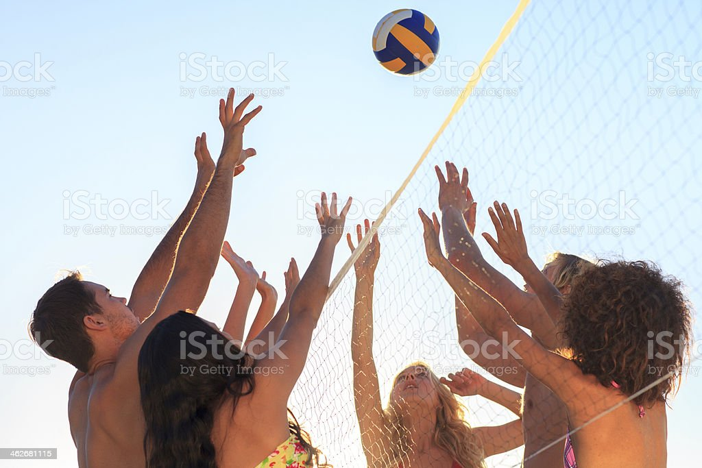 Friends Playing Volleyball Stock Photo - Download Image ...