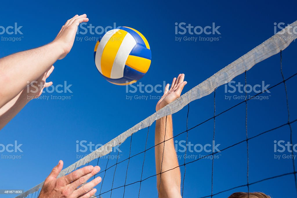 Friends playing volleyball stock photo