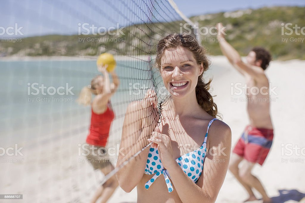 Friends playing volleyball royalty-free stock photo