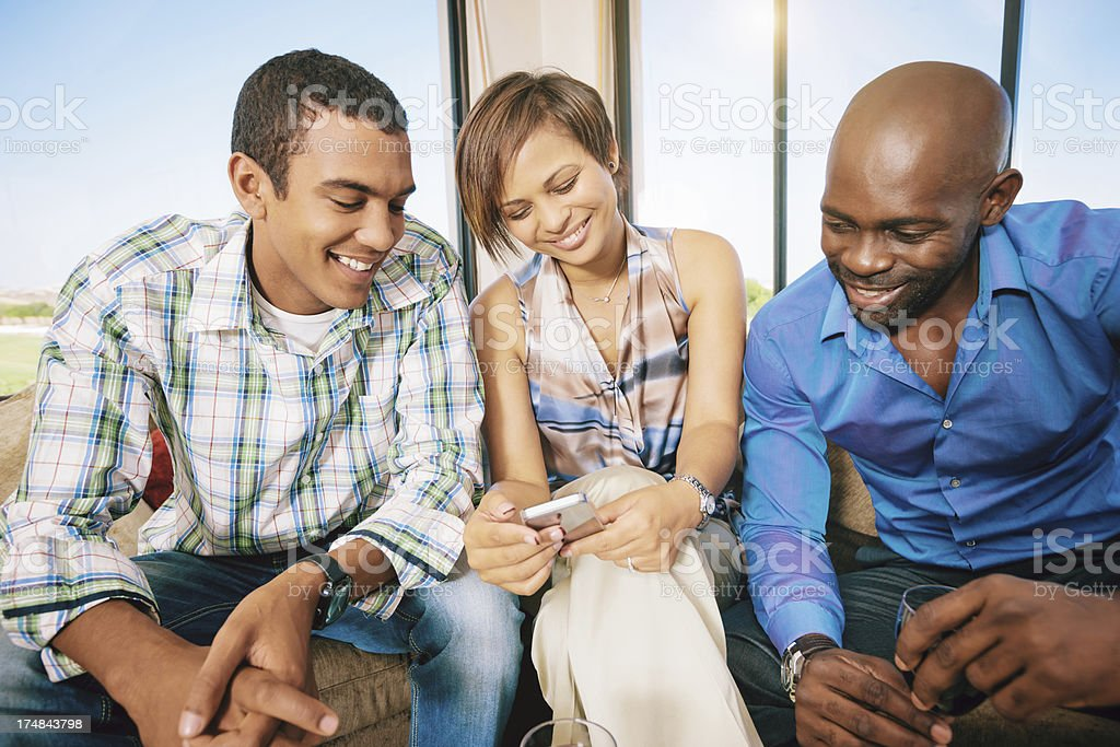 Friends Playing with Mobile Phone royalty-free stock photo