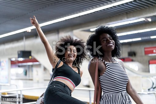 Friends posing and having fun in a subway station