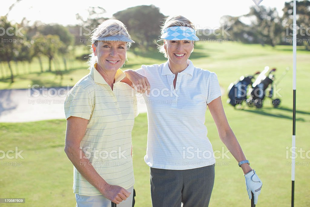 Friends posing on golf course royalty-free stock photo