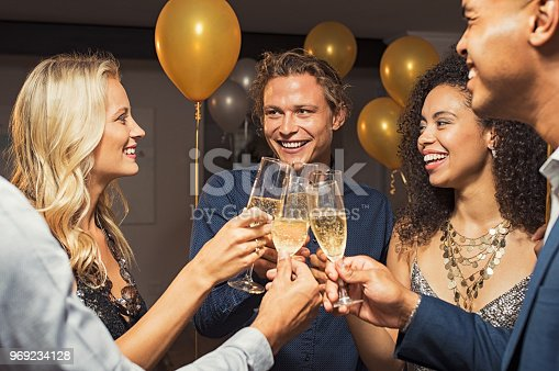 istock Friends raising wine toast 969234128